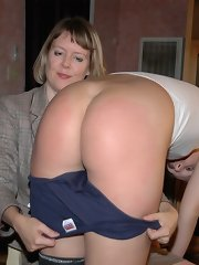 The mistress is spanking a young woman otk