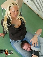 Mistress clutches slave between legs