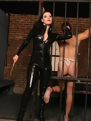 Mistress Anastasia silences her moaning malesub by gagging his mouth with a duct tape