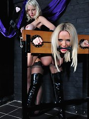 Sexy blond lesbo gags sexy mother i\\\'d like to fuck in the stocks and gives her wazoo a valuable spanking