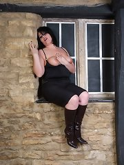 A markedly cuddly again curvy woman enervating shadowy boots besides stripping