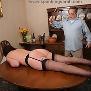 Caning coupled with cocksucking