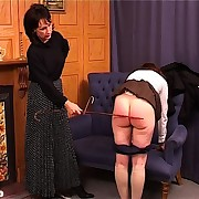 Foxy femdom teacher spanks a pair of schoolgirls