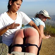 Strict mistress OTK spanked a babe in the open air