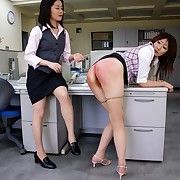 Bad girl spanked by ruler in office