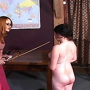 Hot cutie receives her butt caned by headmistress Gemini