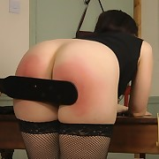 The boss spanked his young secretary bottom by a paddle