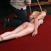 Hogtied on the ground and abused