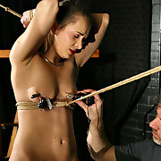 Tied girl painfully balanced on her cunt