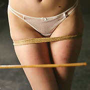 Girl tied and caned on the bench