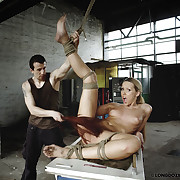Suspension with full body vassalage and whipping for Nicole.