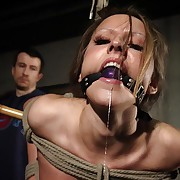 Gagged Nicole in full circle subjugation with biting agitating pain.
