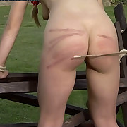 Two misbehaving beauties tied to a bench for a brutal spanking