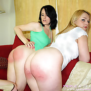 A brunette unreserved spanked a blonde unreserved