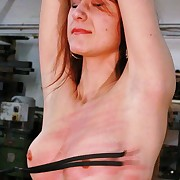 Support redhead with tiny tits gets whipped on her wet pussy till it is glowing