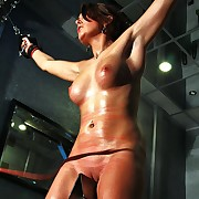 Cute blonde is suspended nude nigh chains and ultra harsh bullwhipped on tits ans pussy while riding a iron pale