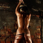 Blonde is tied close to blindfolded and lashed in dark prison where nobody could hear her cries underneath the flog