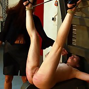 Hot red bare ass and succulent pussy in sadistic fomentation torture with her legs tied up
