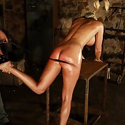 Kirmess babe is hanged hard by ropes and serious lashed on her ass and back nigh dungeon