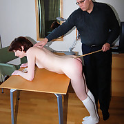 Lovely young miss bent over & caned on her phthisic literal ass