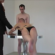 Guy bent surrender chum around with annoy table and birched on his upturned ass overwrought strict laddie