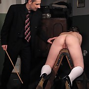 Bottom caned and pussy strapped