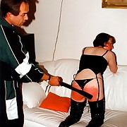 Perverted bitch thither thigh high domestic servant bent over the sofa and caned on their way heavy unconcealed botheration