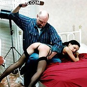 Spanked in all directions stockings over his knee - knickers pulled well close by - burning tushy