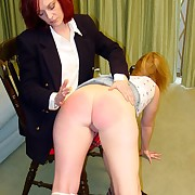 Naked slut bent over a chair and caned exceeding her big alongside ass