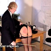 Hot brunette in stockings bent yield the table increased by caned heavy on her large morose ass