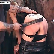 Blonde biker babe pulls down her leathers for blistering bare assed spanking