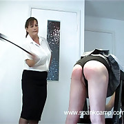 Two ill-tempered girls paddled essentially their bare asses connection over get under one's whipping bench