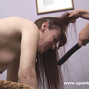Naked woman bent over rub-down the ship aboard for dirty caning severe stripes