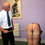 Pretty brunette strapped added to caned exceeding her lovely in one's birthday suit bottom - deep stripes