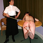 Stabbing caning for naked girl inclination across an obstacle table adjacent to pain
