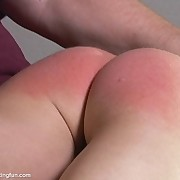Brunette gets her bare ass spanked