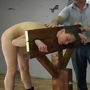 With her head and hands in the stocks, this babe faces her fate