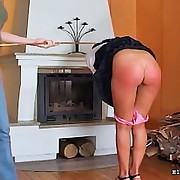 Girl surrounding mini skirt receives her red arse caned