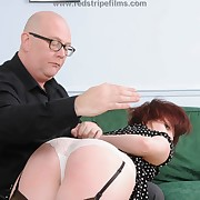 Lustful puss gets vicious spanks on the brush derriere