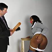 The ball gagged ebony chick was paddled a lot