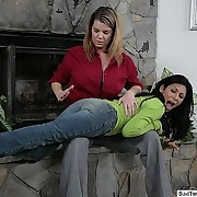 Exotic gal over the knee spanked by the fireplace