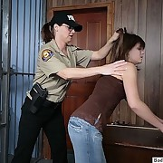 Female cop spanks a gal for getting arrested
