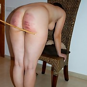 Stunning brunette with big boobs is caned brutally