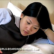 Asian schoolgirl was punished by paddle on the bed