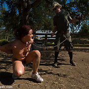 Two slaves bound and fucked outdoor