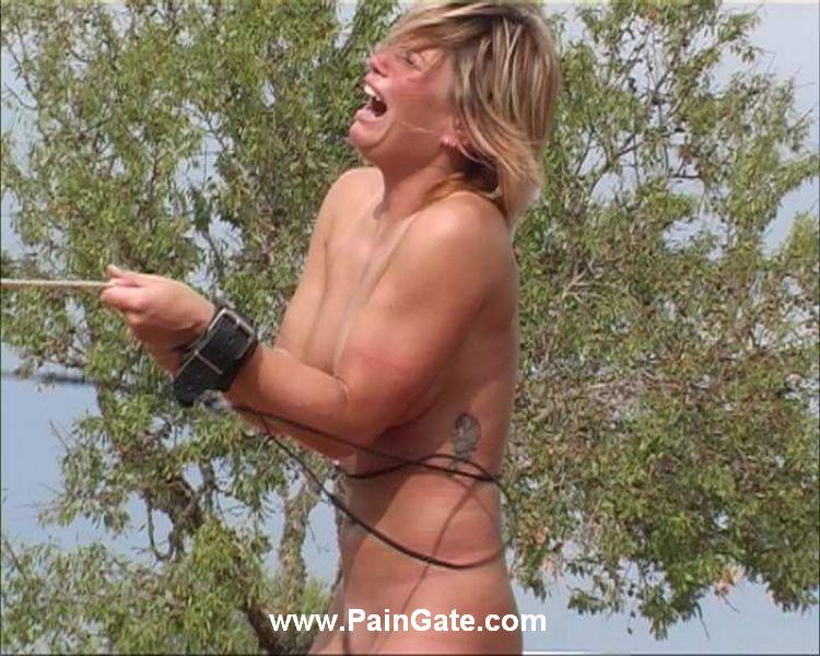 Bdsm spanking outside