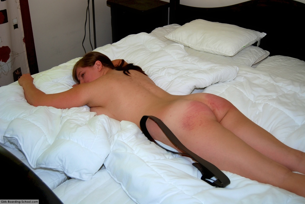 Bare bottom spanking with belt