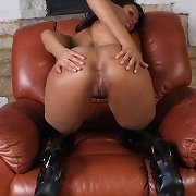 Naughty brunette hair Dani likes to play with her cookie and leather boots