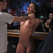 Shocked brunette in bondage