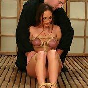 Tied naked slave in grip